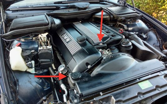 The arrows indicate where the solenoids are when the VANOS unit is installed.