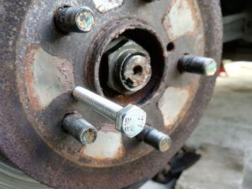 Brake disc release bolt