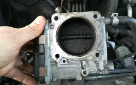 Serious amounts of carbon caked onto the throttle body. That won't help anything.