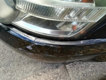 Notice the big gap between the headlamp and bumper cover as a result of the hit.